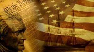stock-footage--we-the-people-background-with-us-flag-and-old-ship (1)